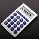 tax or taxes concept with business calculator and word blog